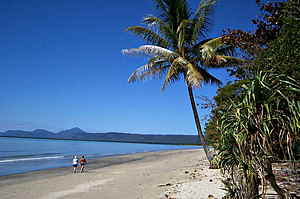 People walking on Newell Beach in the Daintree