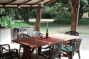 Barbeque with table, chairs and candle